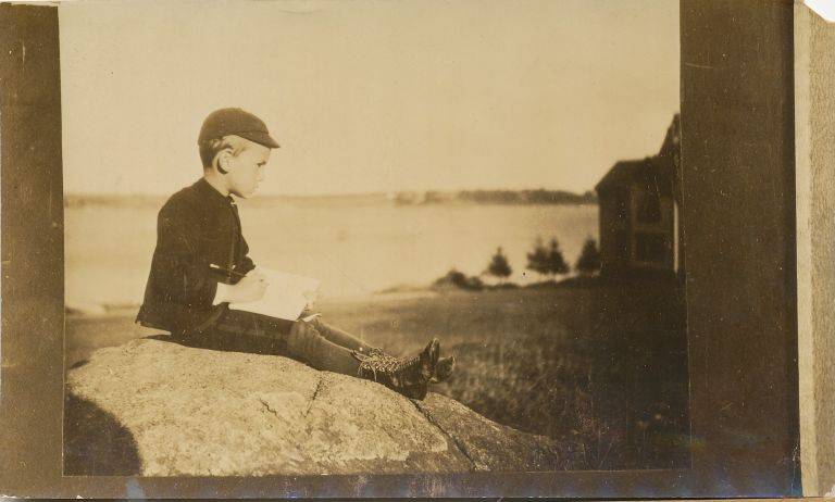 Photograph of O'Neill as a boy, later print with photographer's stamp on verso, oblong 8vo, ca 1918 1920; with signed small 12mo visiting card. EUGENE O'NEILL.