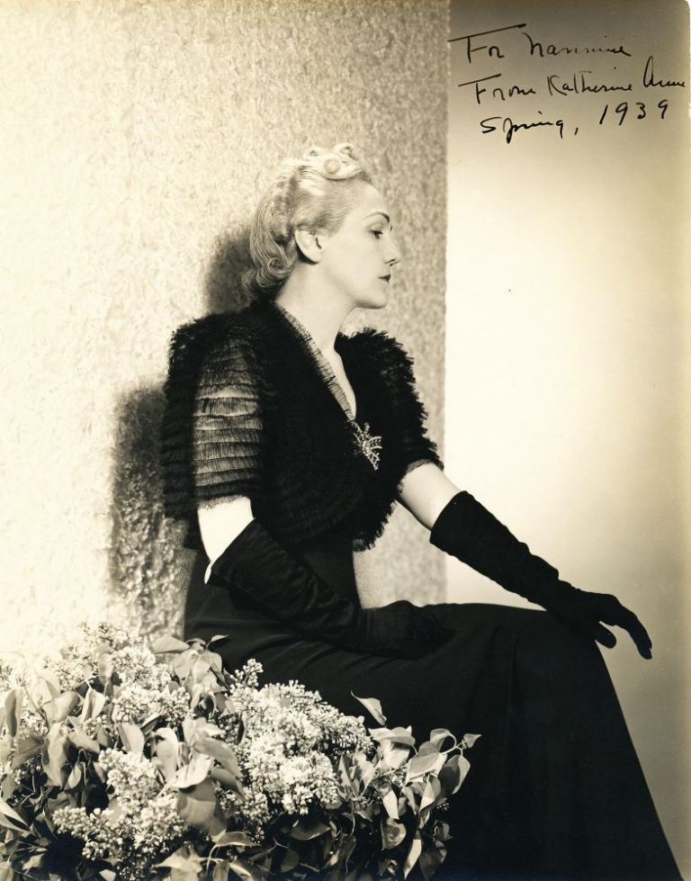 Signed Photograph of Porter by Platt Lynes, 7 x 9 inches, sepia toned, inscribed in 1939, with photographer's stamp on verso with notation. GEORGE PLATT LYNES, KATHERINE ANNE PORTER.