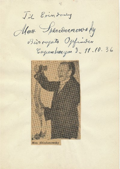 Inscription on 8vo sheet to which is affixed a newspaper photo of him holding film, Copenhagen, Oct. 11, 1936. MAX SKLADANOWSKY.