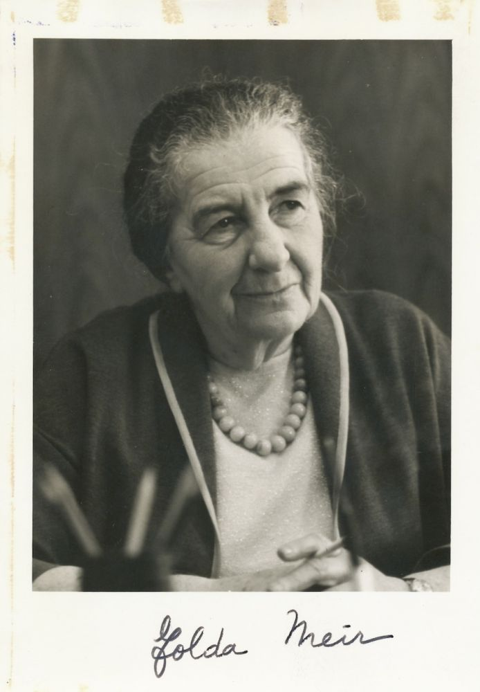 Black and white Photograph Signed, small 8vo, signed on lower white border. GOLDA MEIR.