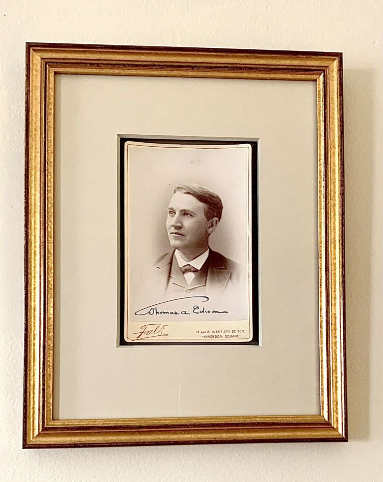 Scarce early Cabinet photograph by Falk ( New York City) of the young inventor beautifully signed. THOMAS ALVA EDISON.