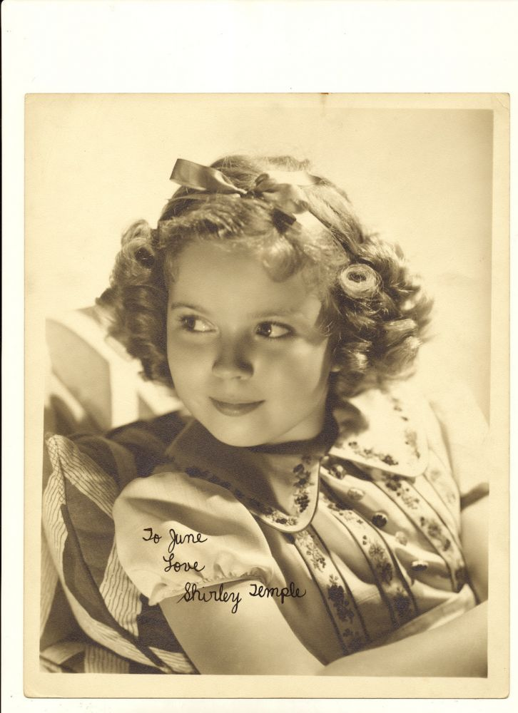 Vintage 8x10 matte finish silver tone publicity portrait, circa 1935, signed and inscribed in black fountain pen. SHIRLEY TEMPLE.