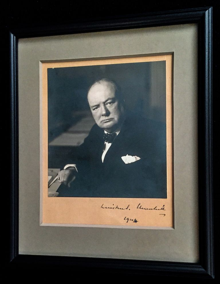 Prime Minister Churchill signed this iconic Stoneman photograph in 1944, towards the end of World War II. The photograph is a gelatin silver print signed on original mount measuring 6.5 by 5.9 inches. Photographer Walter Stoneman studio stamp on verso. The classic image is framed in black wood and museum glass, soft gray archival mat with opening on verso to show Stoneman's studio stamp. WINSTON CHURCHILL.