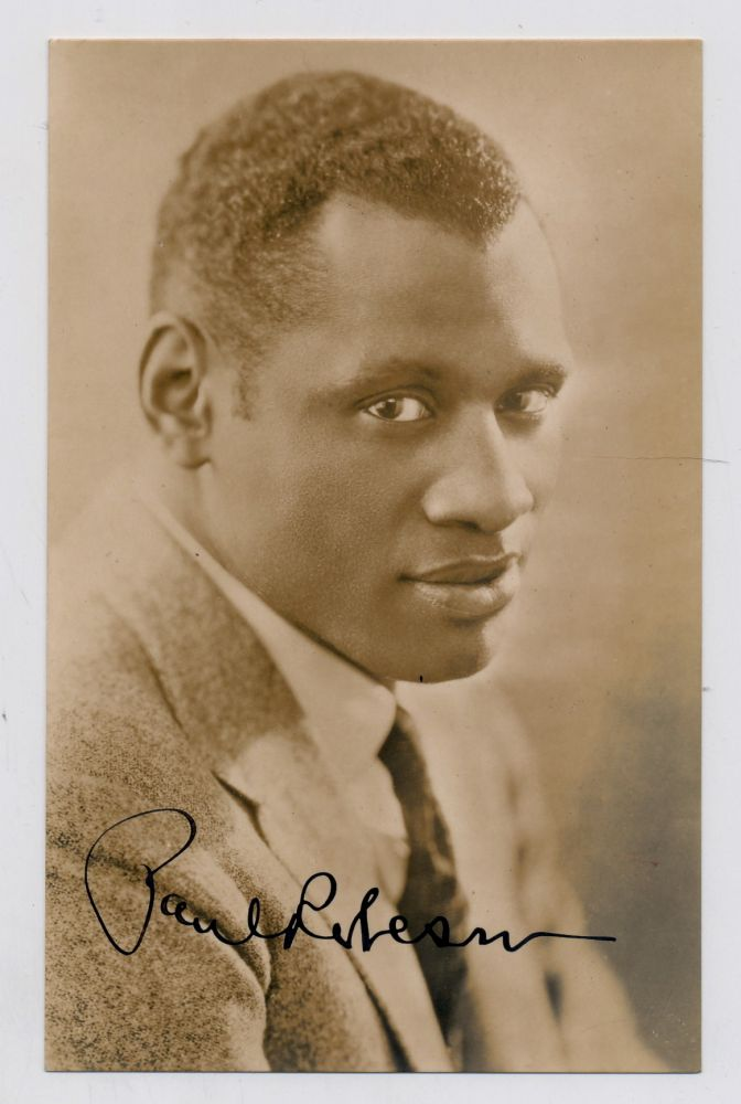 Photograph Signed, bust length, sepia toned, post card size, docketed 1933. PAUL ROBESON.