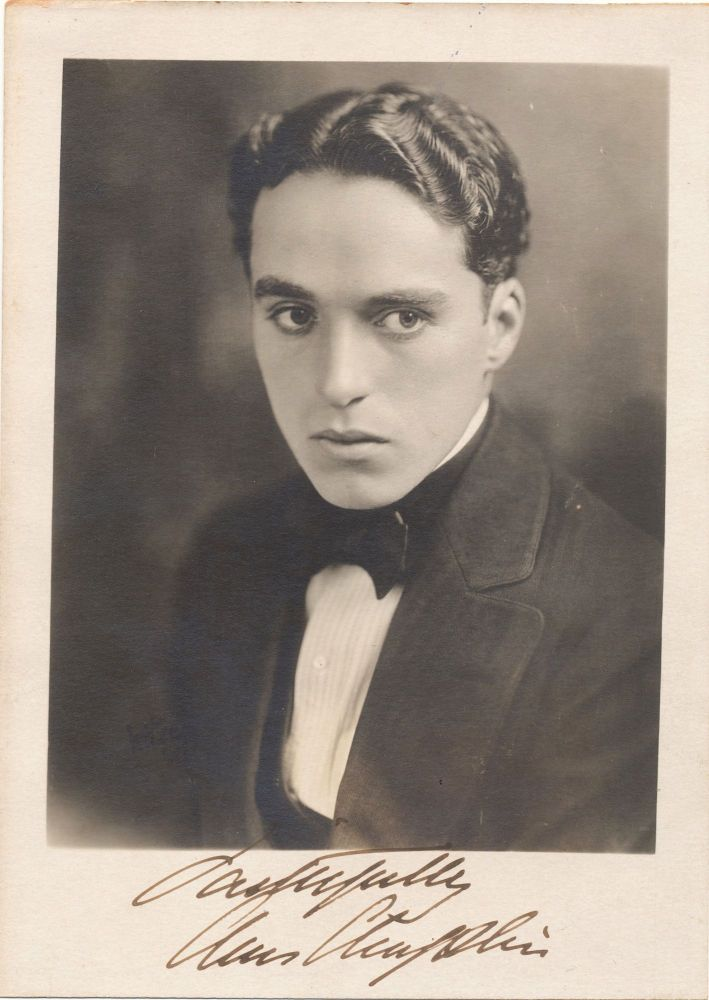 Youthful Original Vintage Photograph, Signed, 7 x 5 inches, August 1919, dated on verso. CHARLIE CHAPLIN.