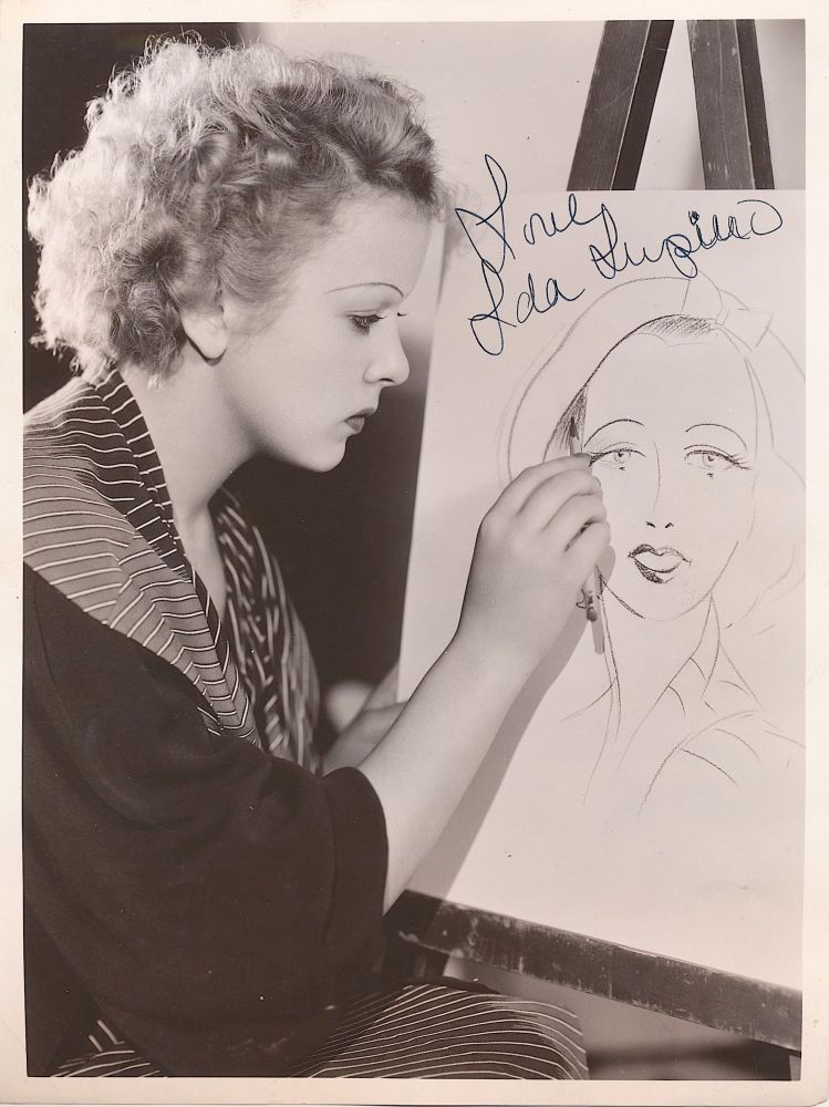 Early Signed Photograph with Paramount studio caption on verso, stamped June 29, 1934. IDA LUPINO.