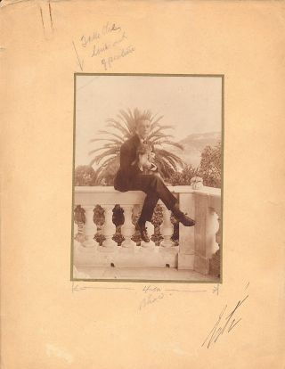 "Original Photograph Signed, sepia toned, 8vo attached to a folio board, stamped on verso, ""Harper's Bazar, 1/15/19"" ERTÉ, Romain de Tirtoff."