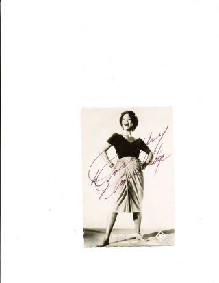 "Signed Photograph, sepia toned, small 8vo, showing Dandridge full length as Carmen Jones, as printed in white on lower margin with the 20th Century logo. She signs boldly across her light skirt and background, ""Dorothy Dandridge."""