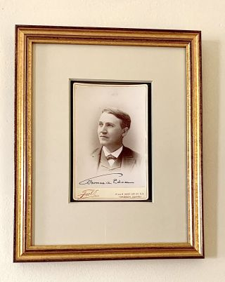 Scarce early photograph, beautifully signed, of the young inventor. THOMAS ALVA EDISON.