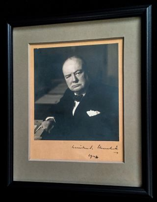 Prime Minister Churchill signed this iconic Stoneman photograph in 1944, towards the end of World War II. The photograph is a gelatin silver print signed on original mount measuring 6.5 by 5.9 inches. Photographer Walter Stoneman studio stamp on verso. The classic image is framed in black wood and museum glass, soft gray archival mat with opening on verso to show Stoneman's studio stamp, with frame measuring 10 x 12 inches. WINSTON CHURCHILL.