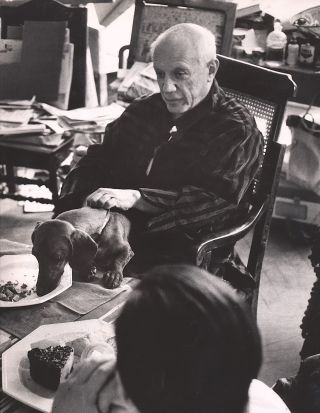Large photograph of Picasso with Lump, his beloved dachshund; black and white gelatin silver...