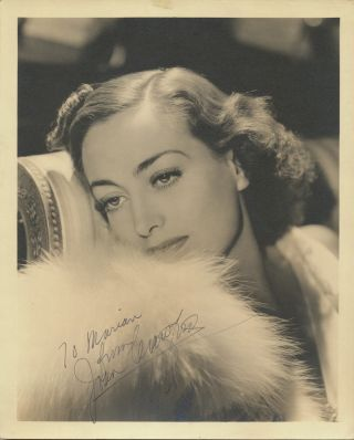 Photograph Signed. Superb original bust-length portrait close-up , 4to, n.d., ca early 1930s. JOAN CRAWFORD.