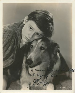 "Signed Photograph with ""Lassie,"" black and white glossy, 8 x 10, with studio mark and description on verso. LASSIE, RODDY MCDOWALL."
