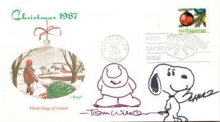 "Snoopy, full length and smiling, and Ziggy, also full length, look out to the viewer of this Christmas 1987 First Day Cover, postmarked, ""Holiday, CA"" Oct. 23, 1987. CHARLES M. SCHULZ, TOM, WILSON."