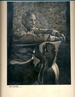 Photograph by Karsh of Picasso with large vase, black and white. Signed by Karsh in dark pen, on...