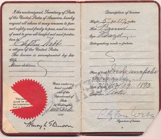 Passport with photograph, signed, 1930 date of issue.