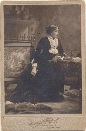 Albumen print on photographer's mount, Bartlett F. Kenney, Boston. LOUISA MAY ALCOTT