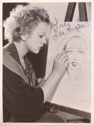 Early Signed Photograph with Paramount studio caption on verso, stamped June 29, 1934. IDA LUPINO